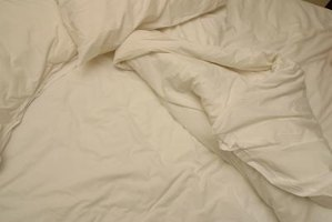 Use a protective liner on your down comforter to prevent fill leaks.
