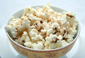 Movie theaters typically use many artificial ingredients to flavor their popcorn.