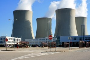 Splitting the atom is the process used in running a nuclear power plant.