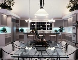 Chandelier style pendant lights over a kitchen island.