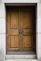 Wooden doors take their share of wear and tear.