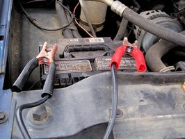 Hook up a set of jumper cables to a working vehicle to jump-start your Explorer.