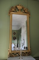 One mirror may be fine, but a wall of mirrors presents a different challenge when updating a room.