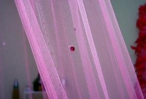 If your sheer curtains don't fit, hem them yourself in a few simple steps.