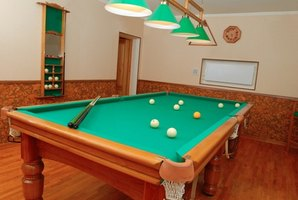 Turn your unused dining room into a game room for your family.