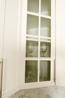 Add glass fronts to several of the cabinets you recycle.