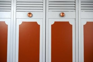 These bifold closet doors have top vents and pull knobs.