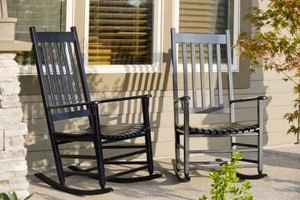 Create a place to sit and relax on a bi-level front porch.
