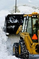 A front end loader can move tons of snow in a short amount of time