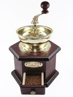 Manual coffee grinders often use burrs, not blades, for grinding beans.