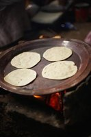 Tortillas traditionally are made from corn or flour.