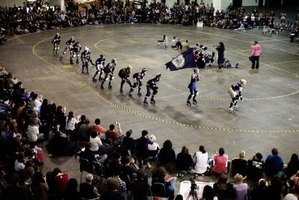 Roller Derby leagues depend on non-skating officials to make bouts run smoothly.