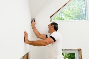 Before you paint, seal the seams between wallboards.