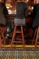 Give your guests a place to sit by building your own bar stools.
