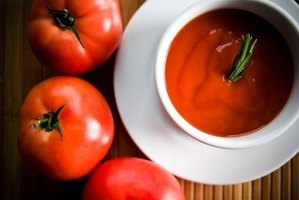 Garnish tomato soup with green onions.