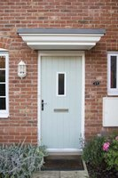 Brick molding covers the gap between your door and the brick.