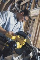 Bench saws, such as miter saws, speed up the vinyl siding installation process.
