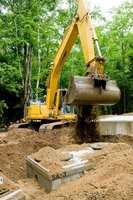 Digging out a septic tank for repair or replacement is a major operation.