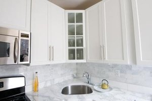 Clean grimy kitchen cabinets with common household products.