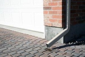 A properly installed downspout directs the water away from the home.