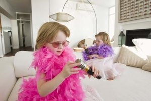 Three-year-old girls enjoy games like dress-up and make-believe.