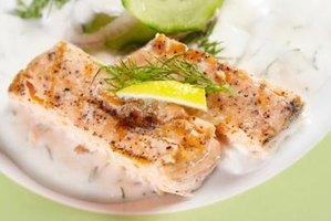 Baked salmon with lemon and dill is light and fluffy dish.