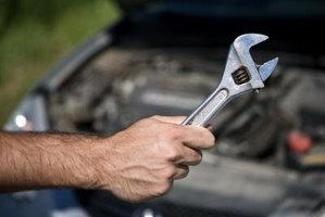 Use an adjustable wrench to dissassemble the engine in order to access the head gasket.