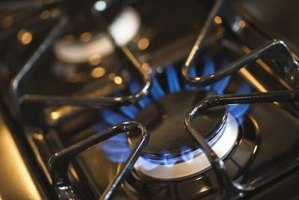Adjust a gas burner until it produces a clean blue flame.