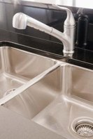 Caulking around a faucet prevents leaks from forming.
