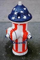 Create a cake to resemble a fire hydrant.
