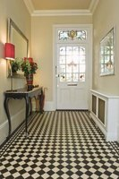 An intersting floor design gives a foyer style.