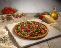 Pizza stones are commonly made from soapstone which allows heat to distribute evenly.