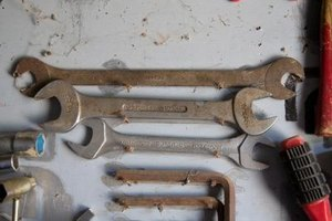 Reddish-brown discoloration is an indication of rust on tools.