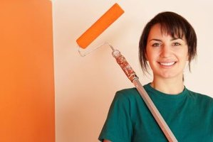 Use a paint roller to apply textured paint to walls.