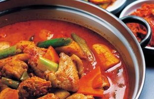 Red curry paste is essential in Thai curry dishes, though powdered curry can be substituted.