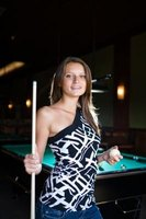 Good pool cues are made of solid wood and exchangable tips.