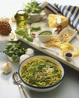 Spaghetti with pesto and pesto ingredients