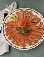 Smoked salmon tastes delicious on its own with a little lemon and sliced cucumbers.