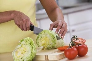A cutting board and a set of kitchen knives are basic tools needed in most home kitchens.
