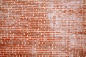 Brick wall with fading and stain damage.