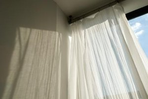 White curtains brighten up a room while providing privacy.