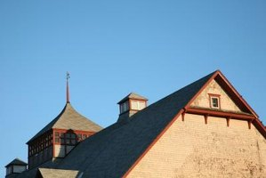 A gable end roof usually features a vertical wall, a straight roof ridge and a pitched roof.