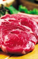 Raw steaks can lose their red color because of oxygen exposure.