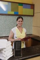 A good receptionist welcomes guests with a smile and a courteous attitude.