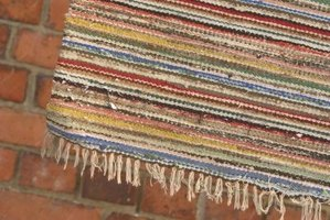 Braid monochromatic strips and sew them side-by-side for a rectangular rug.