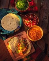 Arrange taco fillings on a table so family and guests can suit their own tastes.