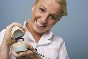 Dental assistants may learn skills, like creating teeth molds, on the job instead of getting a degree.