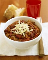 Chili con carne is a hearty dish that can be served with a variety of accompaniments.