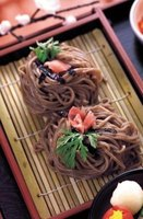 Soba noodles are often served as street food with a variety of accompaniments.