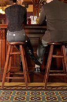 Wooden bar stool are a classic option for a home bar with a traditional pub-like design.